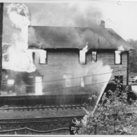Removal of the B. and M. Freight House by Burning and as a Fire Fighter's Training Exercise. 7/12/1975. First Roof Collapse.