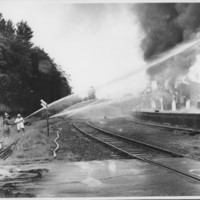 Removal of the B. and M. Freight House by Burning and as a Fire Fighter's Training Exercise. 7/12/1975. Hose Company on East Side.