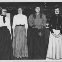 Parade Sideline: Costumed Ladies.