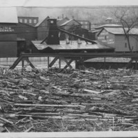 Flood: November, 1927. Drift Logs in Canal.