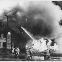 Removal of the B. and M. Freight House by Burning and as a Fire Fighter's Training Exercise. 7/12/1975. Flame Breaks on West Side.
