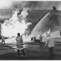 Removal of the B. and M. Freight House by Burning and as a Fire Fighter's Training Exercise. 7/12/1975. The Aerial Comes Into Play.