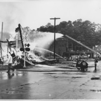 Removal of the B. and M. Freight House by Burning and as a Fire Fighter's Training Exercise. 7/12/1975. Soaking It Down.