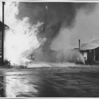 Removal of the B. and M. Freight House by Burning and as a Fire Fighter's Training Exercise. 7/12/1975. Water Fans to Protect Nearby Buildings.